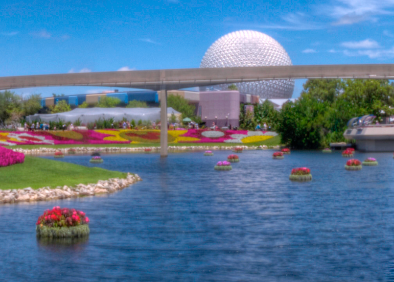 BioHaven Floating Island Gardens at Epcot show the many uses of the floating island. Spaceship Earth appears behind the monorail over the pond islands